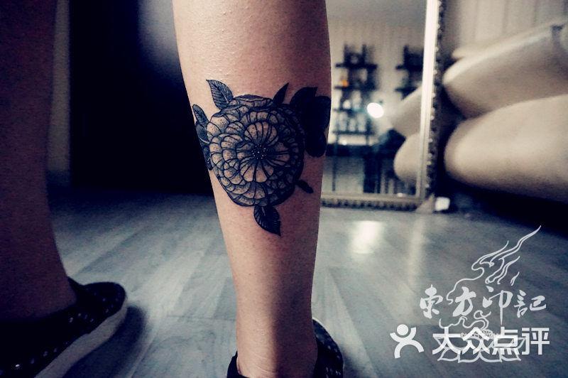 小腿山茶花纹身——北京最好的纹身店