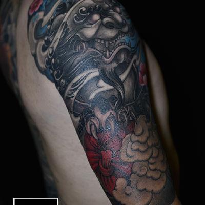 包大臂唐狮纹身款式图